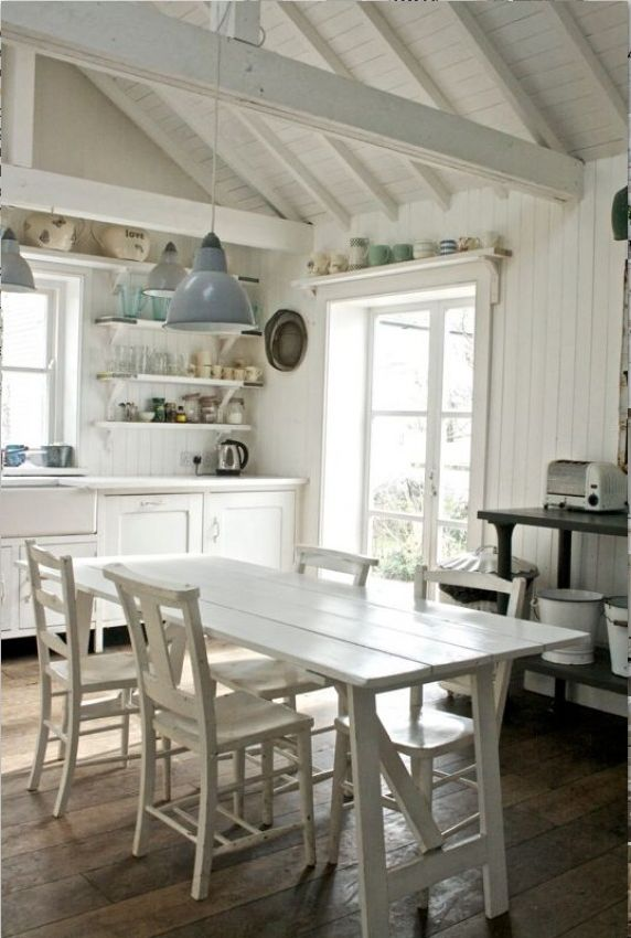 Love the openness, the shelves, the flooring, that table & chairs. But ~~ where is the color?? This, to me, is just COLD!!