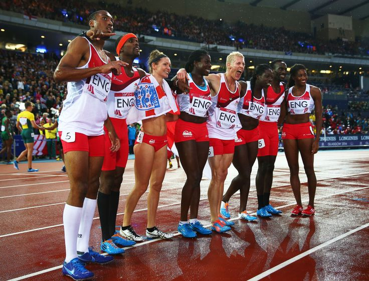 Conrad Williams, Matthew Hudson-Smith, Michael Bingham and Daniel Awde of England pose with the Bronze medalists Women's 4x400 metres team, Shana Cox, Kelly Massey, Christine Ohuruogu and Anyika Onuora of England