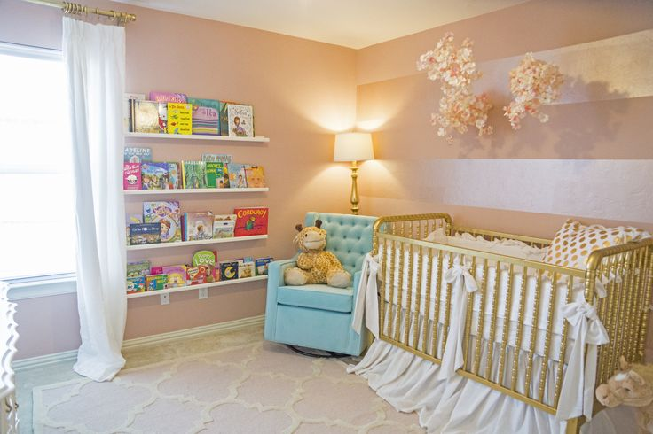 A pink and gold nursery with pops of Tiffany blue. The nursery is a mix of Hollywood regency meets chic airy cottage.