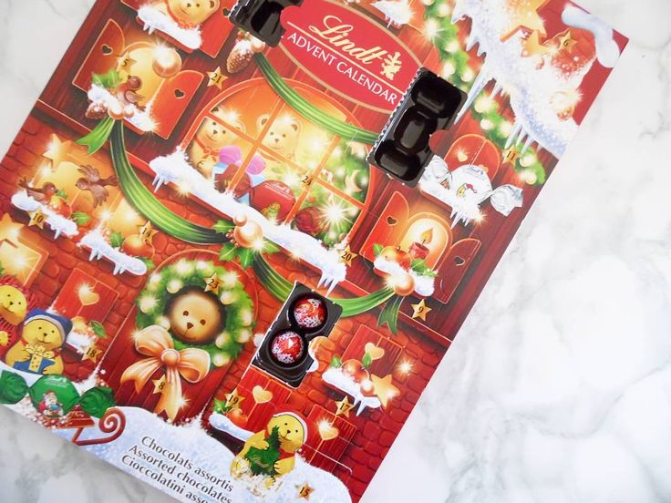 On a list of things that I love Chocolate and Christmas rank in the top 10. So of course when I saw that my husband bought me the Lindt Advent Calendar yesterday I pretty much squealed. Eeep! This is so epic.
