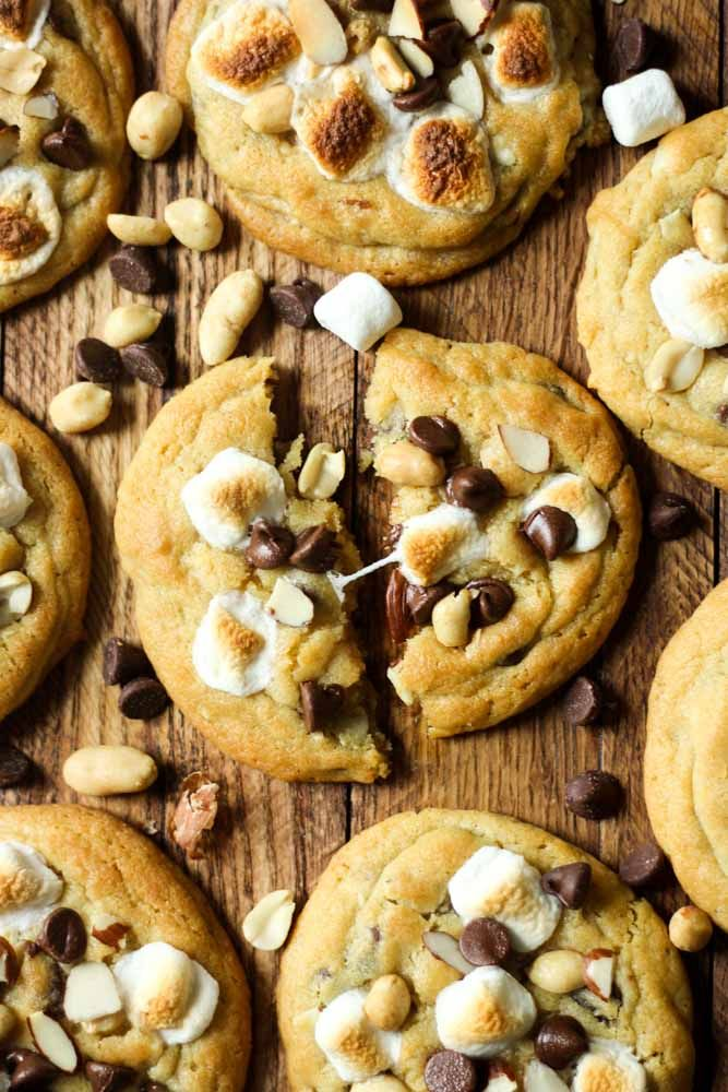 Our famous chocolate chip pudding cookies turned summer classic: Rocky Road Cookies! These warm and gooey cookies are filled with nuts and chocolate chips and topped with a perfectly toasted marshmallow, just what you need this summer!