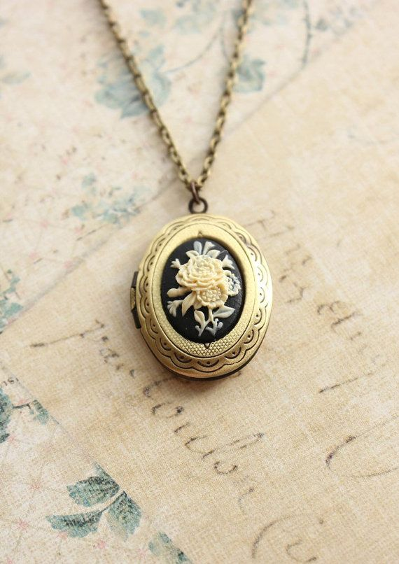 Oval Locket Necklace, Ivory Flower, Black Cameo Pendant, Antique Brass, Resin Cameo, Vintage Style Photo Locket, Secret Hiding Place. $32.00, via Etsy.