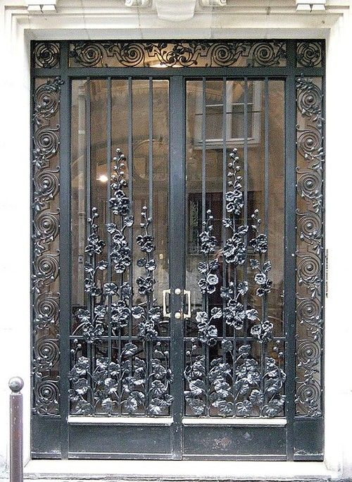 Silver Iron Work On Door.