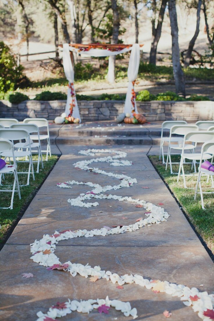 Wedding aisle decor with petals and fall leaves for my rustic fall wedding