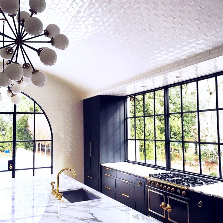 Magnificent white arched tile ceiling kitchen remodel from Benecki Homes + Melanie Turner Interior Design. 3383 Knollwood Drive Atlanta, Georgia.
