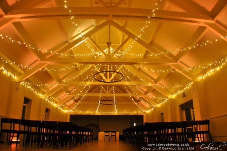 Warm gold uplighting and thousands of sparkling lights in the Ballroom at Stoke Place
