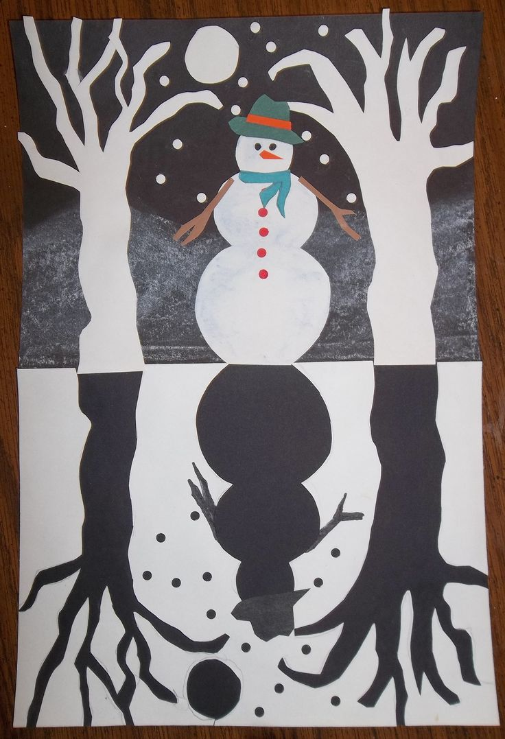 Create a mirrored silhouette with a snowy scene by exploring negative and positive space, mirrored images/symmetry and practicing cutting skills.
