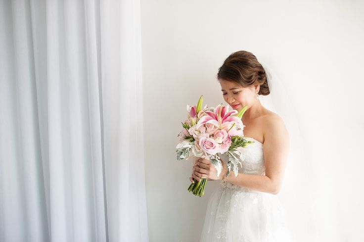 Bride with beautiful Lily bouquet