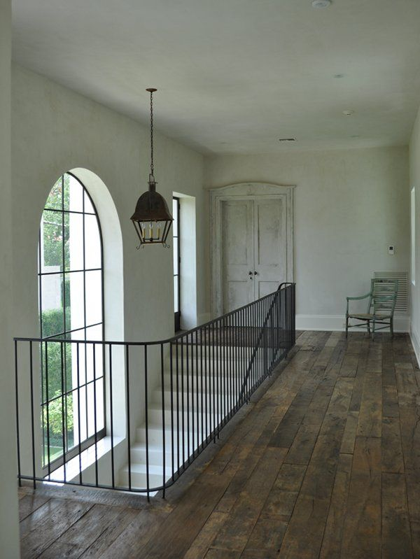 Love all of this, simple iron railing, beautiful steel window, wood floors, and that gorgeous door