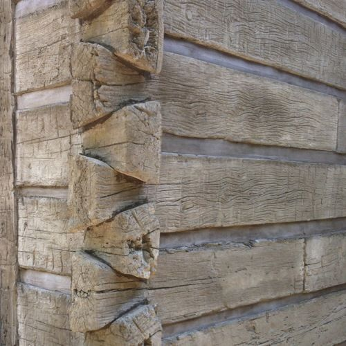 "These ""logs"" are actually a concrete siding. Looks real doesn't it! The look of a log home without the maintenance!"