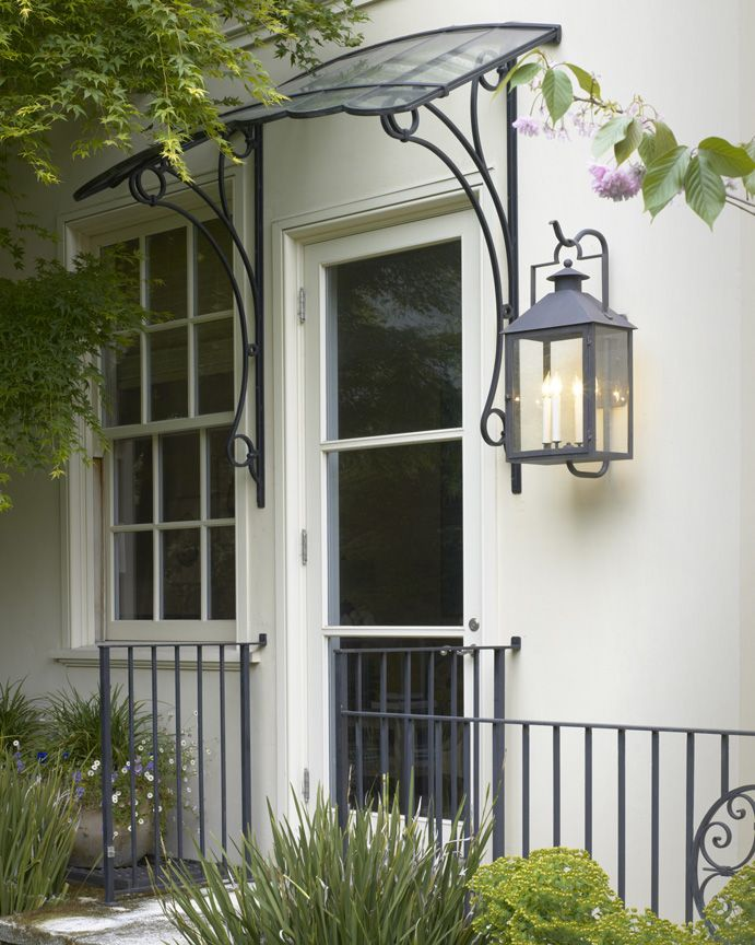 Wrought Iron and Glass Arched Canopy and Copper Lantern at Exterior Door (image via Gast Architects, Beaux Arts Residence)