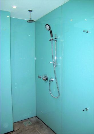 Photograph of shower room fitted with Opticolour aqua wall panels