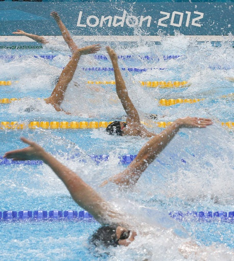 Swimmers compete in a men's 100m Backstroke semifinal at the London 2012 Summer Olympics