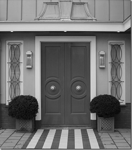 "Charcoal gray entry doors, and really like the striped approach that says ""welcome, this is a really cool place"""