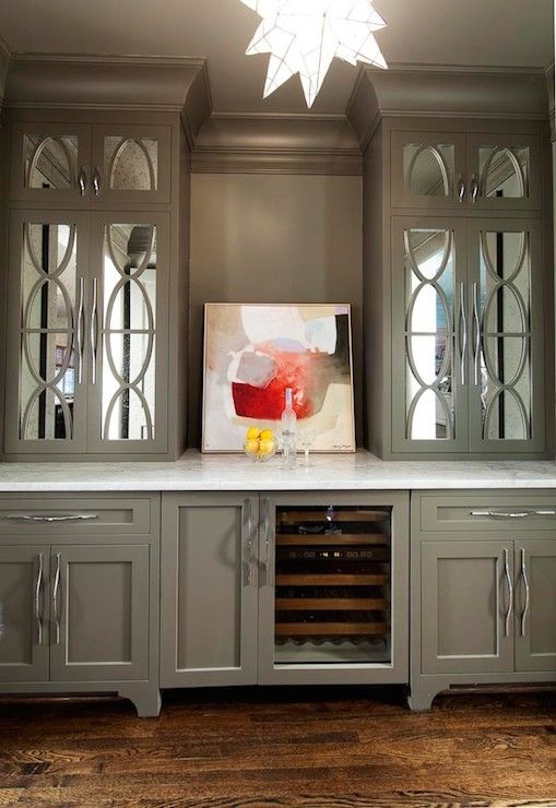 Gorgeous builtin bar with gray upper cabinets accented