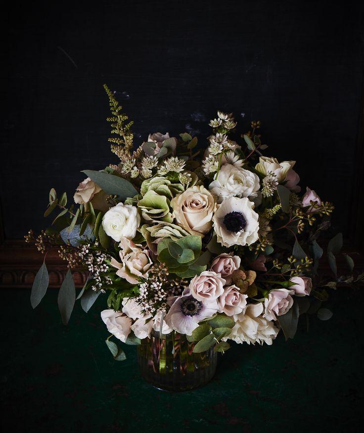 flowers on black background   Flower centerpieces, Flower ...