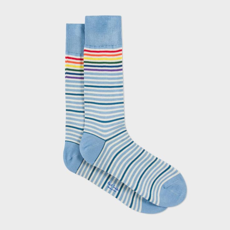 Paul Smith men's socks with sky blue and white stripes and a repeating contrasting darker stripe. Made in Italy, these socks feature multi-coloured stripes near the cuff and are finished with a sky blue heel and toe and ribbed sky blue cuffs.