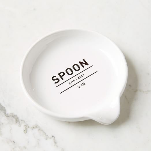 "Utility Kitchen Spoon Rest from West Elm. This stoneware spoon rest is printed with a handy label in a classic font. Made of stoneware in white. 5.75""W x 5.2""D x .5""H. $6.00. Love the simple typography on this spoon rest and the circular surface to rest cooking utensils on."