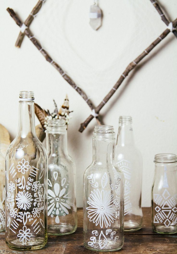 I love these DIY painted bottles. I would paint them with white snowflakes for cute Christmas decor.