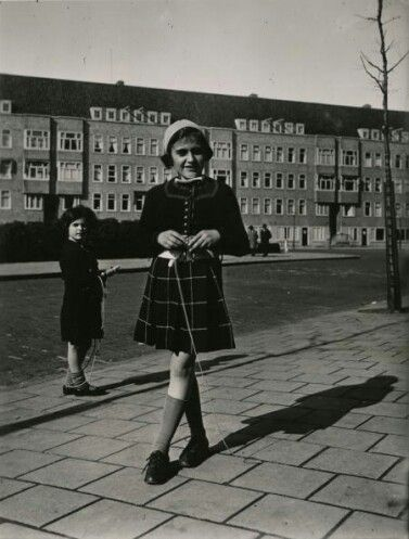 Anne Frank with her friend Sanne Ledermann in the background.
