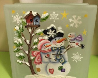 Hand painted Snowman and Snow Woman with Birdhouses on a Glass Block.