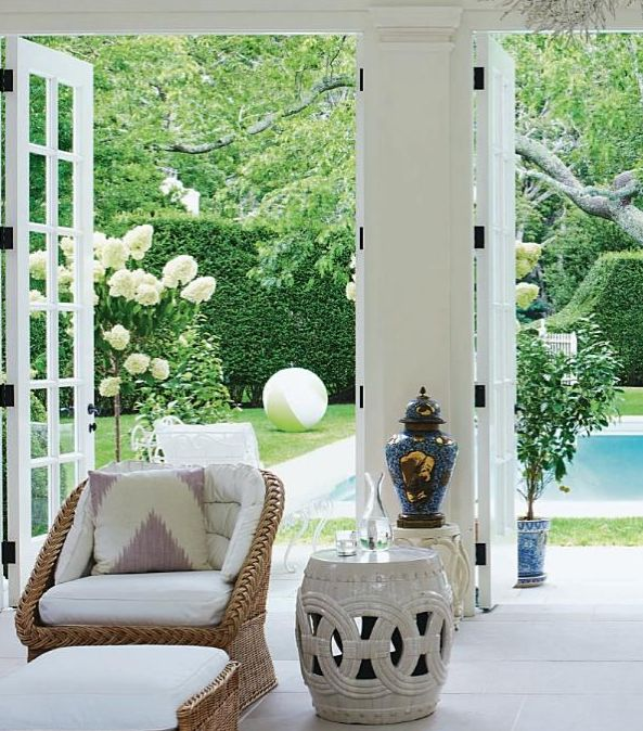 Aerin Lauder's Home- oil rubbed bronze hardware on white french doors