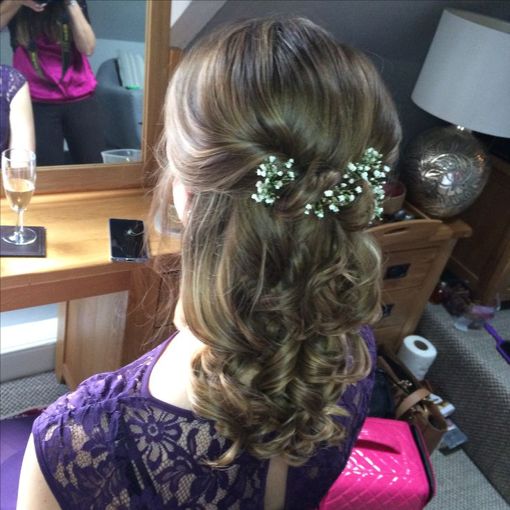 Curled hair style with gypsophila added for finishing touches