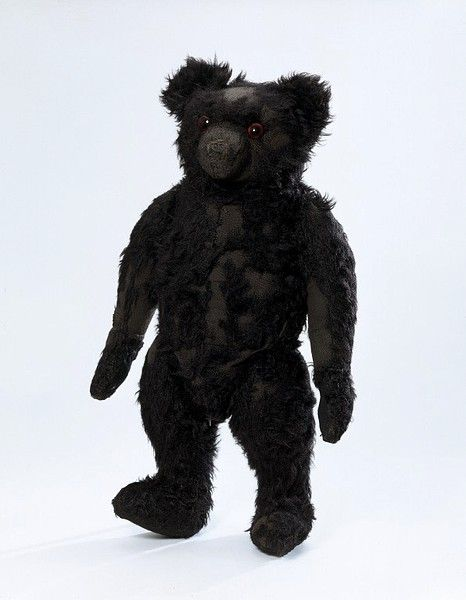 """This teddy bear's name is Blackie, for obvious reasons. It is an early English bear and may have been made to commemorate the death of Edward VII. Black is not a very common colour for teddy bears and is usually associated with a tragic event."""