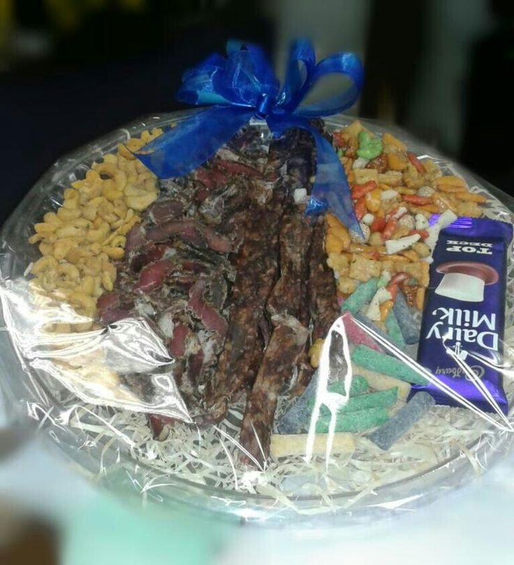 Delicious snacks gift tray with chocolate, biltong, dry wors, nuts, biscuits & fruit sticks.