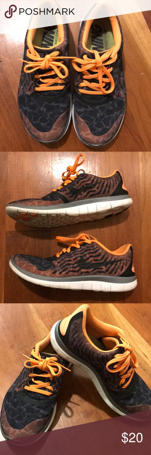 Women's Nike free running sneakers size 7.5 Orange, black and rust colored Nike free running sneakers. Preowned and have been worn but are still in nice used condition. Size 7.5. Nike Shoes Athletic Shoes