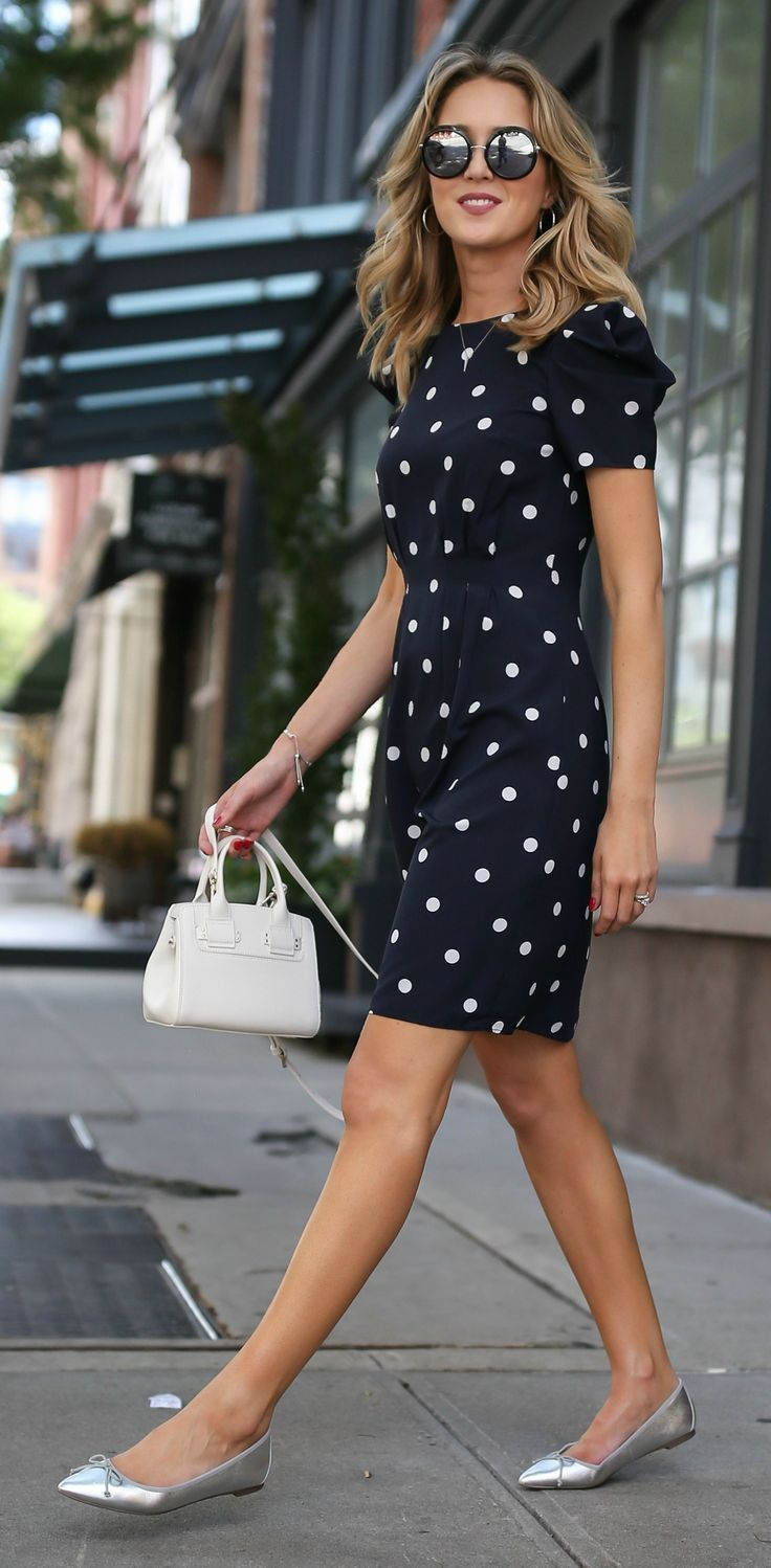Navy and white polka dot dress with shoulder detail and cinched waist + silver flats, white tote, and wavy hairstyle {Banana Republic + Furla}