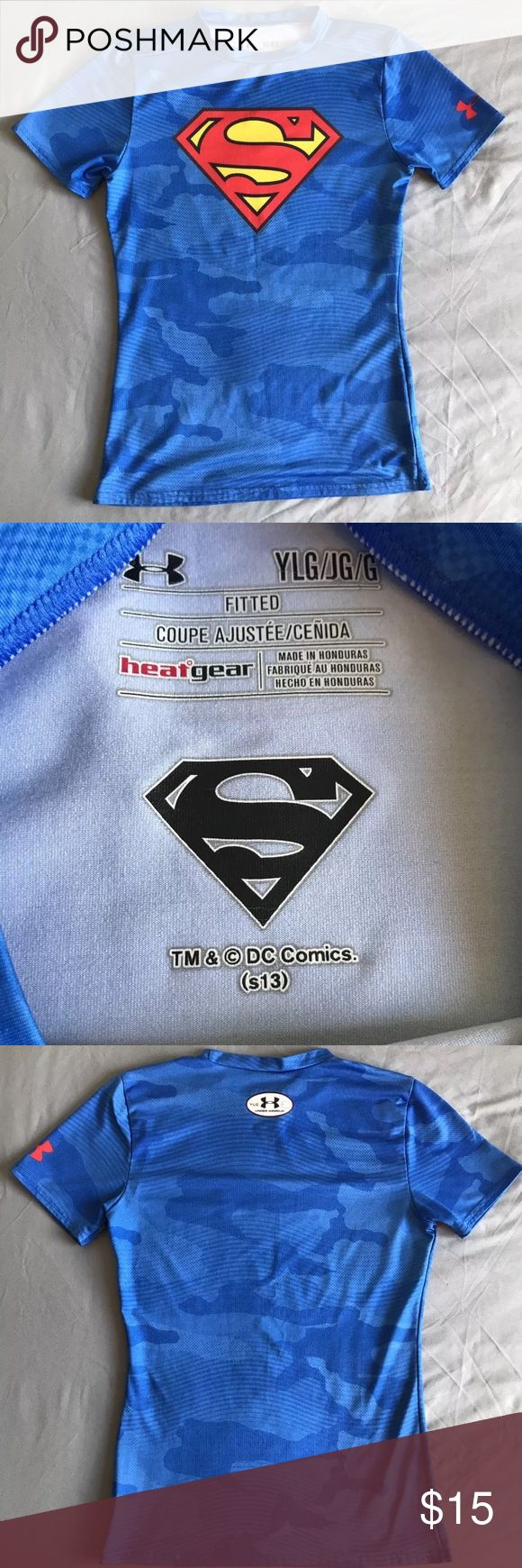 Boy Size L under armour athletic superman fitted Blue fitted camo shirt barely worn any boy would love to have a superman & camo shirt. Two of both worlds Under Armour Shirts & Tops Tees - Short Sleeve