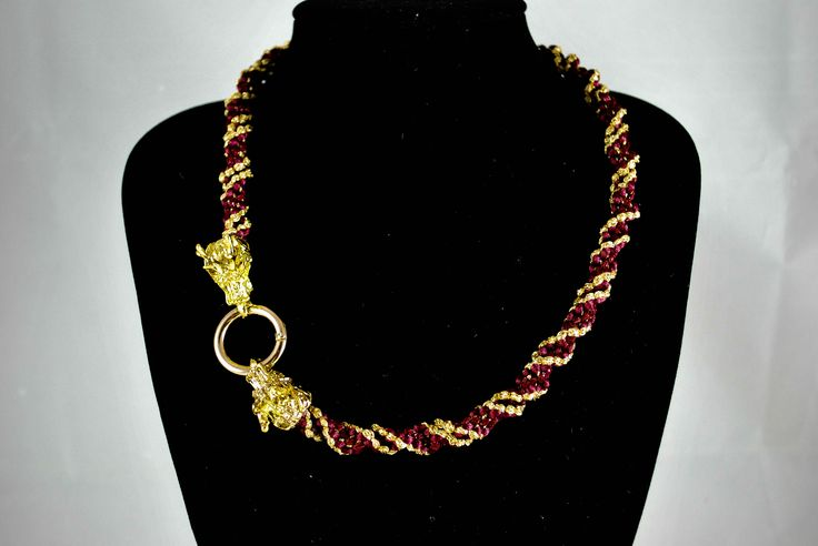 A truly statement necklace: 3D spiral in burgundy red and gold threads finished off with dragonhead clasp. Available at: https://www.etsy.com/uk/shop/Lodorfo