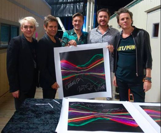 "Visual artist Tim Wakefield created this limited edition artwork from sound waves captured in audio of Duran Duran's ""Hungry Like the Wolf"". Each canvas is signed by the band with proceeds going to War Child UK. Available here: http://duran.io/2gKVN4T"