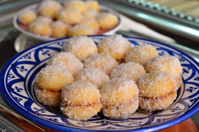 Flavored with apricot jam, orange flower water and coconut, these little Moroccan cookies resemble snowballs. They're also known as Richbond Cookies.
