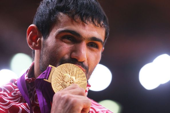 Gold medalist Arsen Galstyan of Russia stands on the medal stand after winning the Men's -60 kg Judo on Day 1 of the London 2012 Olympic Games at ExCeL on July 28, 2012 in London, England.