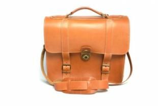 This classic calfskin caramel leather bag is perfect for everyday use. It features two internal compartments and one long, adjustable shoulder strap.  30 x 33 x 8 cm.