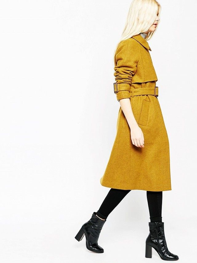 Go bright for winter in a yellow trench coat, leggings, and patent leather boots