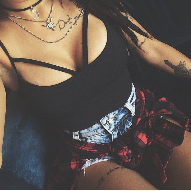 Top, shorts, flannel and jewelry.