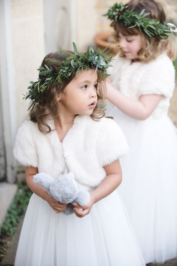 Faux fur accessories make such a stylish addition to any flower girl dress. Paired with greenery crowns, it's an easy and stylish ensemble for a winter wedding. | Faux Fur Inspiration for Brides and Bridesmaids