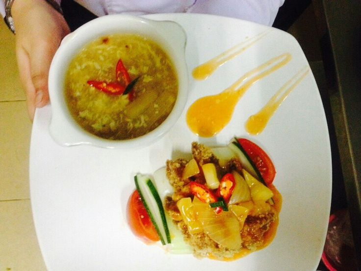 platting  asparagus soup with sweet fish