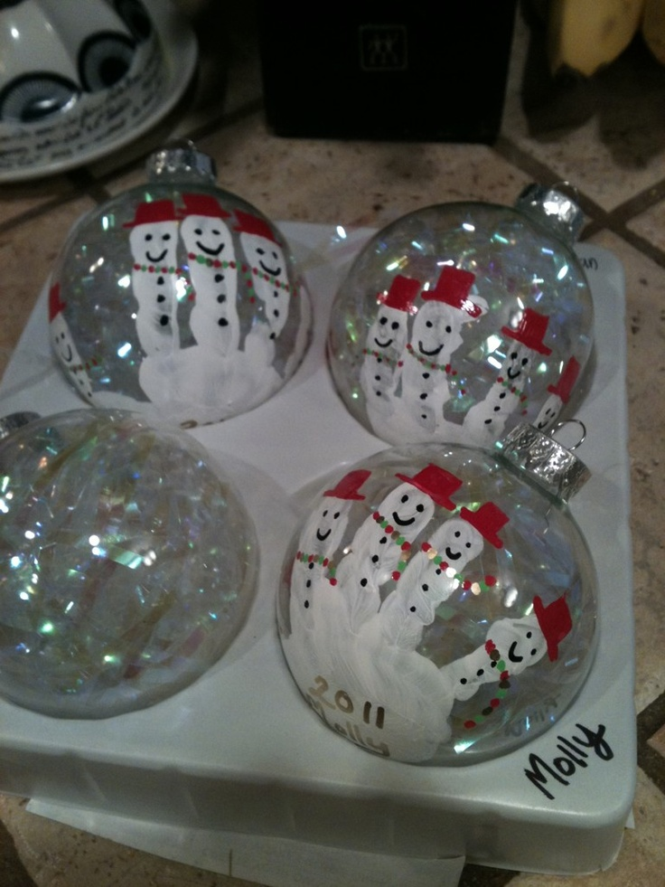 Handprint Ornaments! Lauren had one like this and we loved it..until the dog broke it.  :(