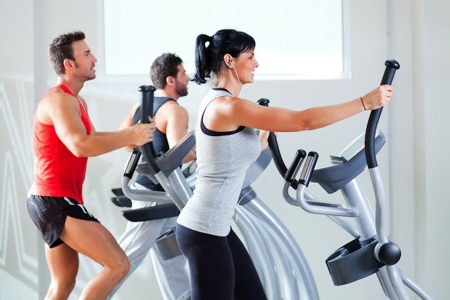 woman on elliptical machine at the gym