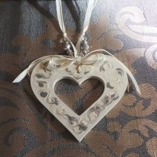 Wedding Charm Heart, (Large) Cream & Silver – Heart Love & Understanding.  Wedding Charms are given to the bride after she is married – usually when the ceremony is over. These symbols of luck, love, growth or transformation are hung on the bride's wrist as a special token of love and friendship for the new bride.  Ancient Realms is designed and handcrafted in Australia. Made from wood, crystal and ribbon. $18.00au
