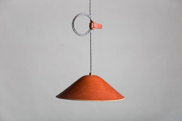 The Loop pendant is a simple lamp wet-formed from a single piece of Italian vegetable tanned leather. The ...