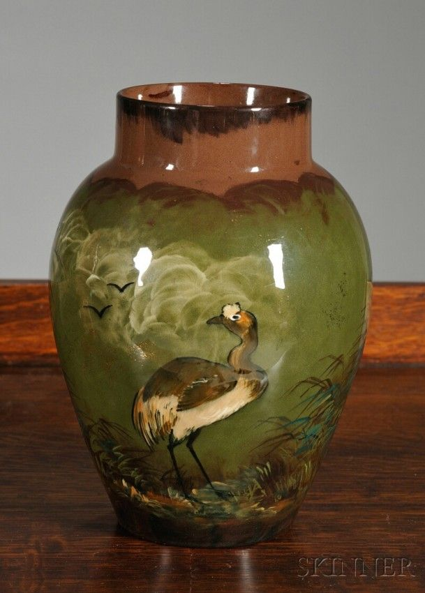 Rookwood Vase Glazed and decorated pottery Decorated by Albert Robert Valentien, Cincinnati, Ohio, 1883 Rookwood pottery vase, short neck on swollen body decorated with two birds standing in grasslands on green ground with gilt specks, stamped with Rookwood 1883, R 103, and anchor mark, artist's initials, and sticker, ht. 8 1/4, dia. 3 1/2 in.
