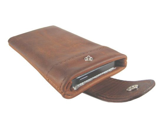 "Cellphone pouche made to measure from genuine brown ""old English"" antique cow leather with flap.  Very robust and hard-wearing and decorated in elegant, simple look. The va..."
