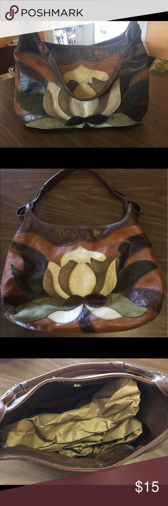 Canyon River Blues faux leather hobo bag Cool faux leather hobo bag - multi-color design on front.  Back is all chocolate brown.  Small stain but other than that in great condition.  Shoulder strap is connected through loop on both sides Canyon River Blues Bags Shoulder Bags