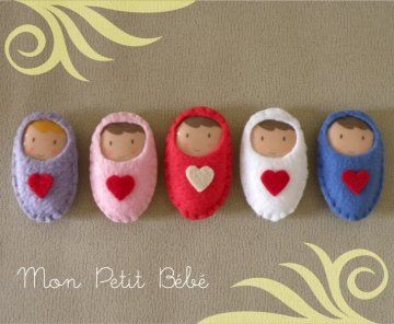 felt babies - brooches to pin on new baby cards, no instructions but could be figured out