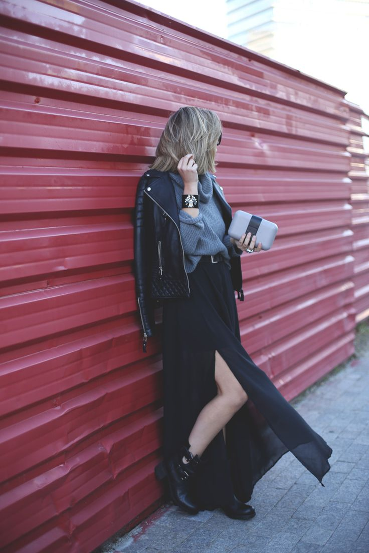 Priscila Betancort is wearing a black maxi dress from Rosewe, black leather jacket from Boda Skins, grey jumper from Benetton and the clutch is from &Other Stories